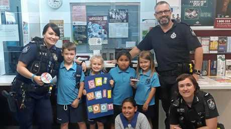 The children from Prep Red at Saint Francis Xavier Primary School visited Goodna Police Station to hand deliver homemade get well cards for Constable Peter McAulay.