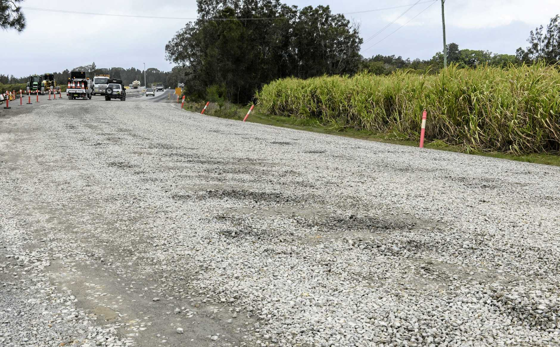 Damage to the road surface caused by heavy rains near Romiaka Channel bridge works.