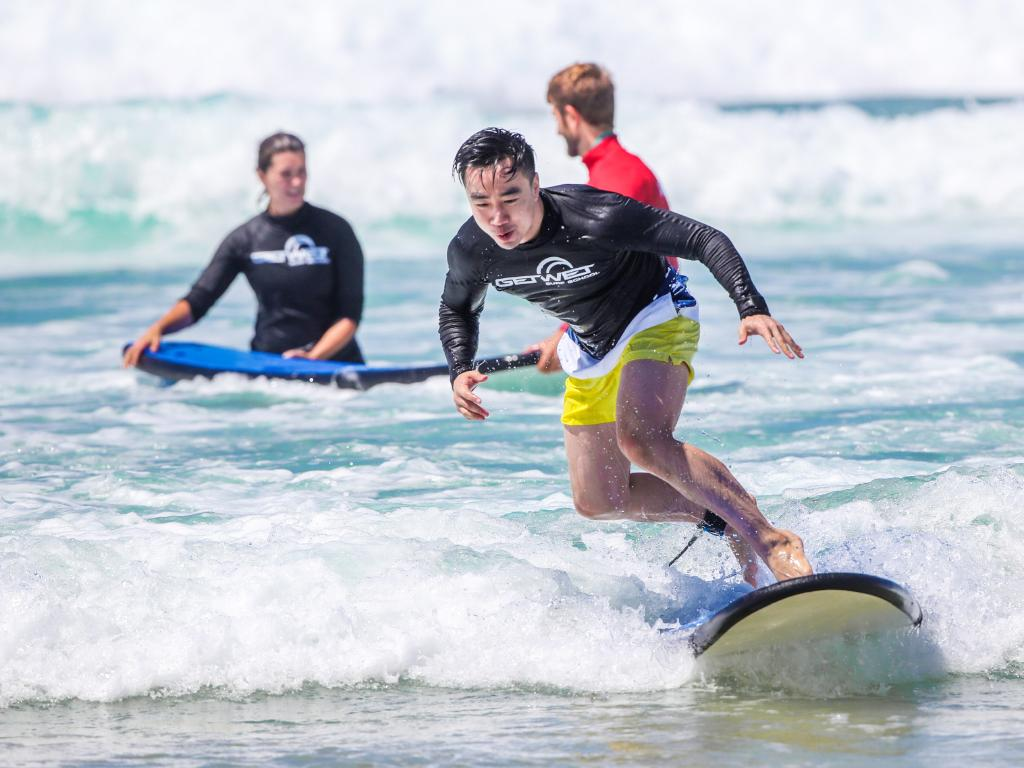 Get Wet Surf School teaches Chinese tourists to surf at The Spit on the Gold Coast. Picture: Nigel Hallett