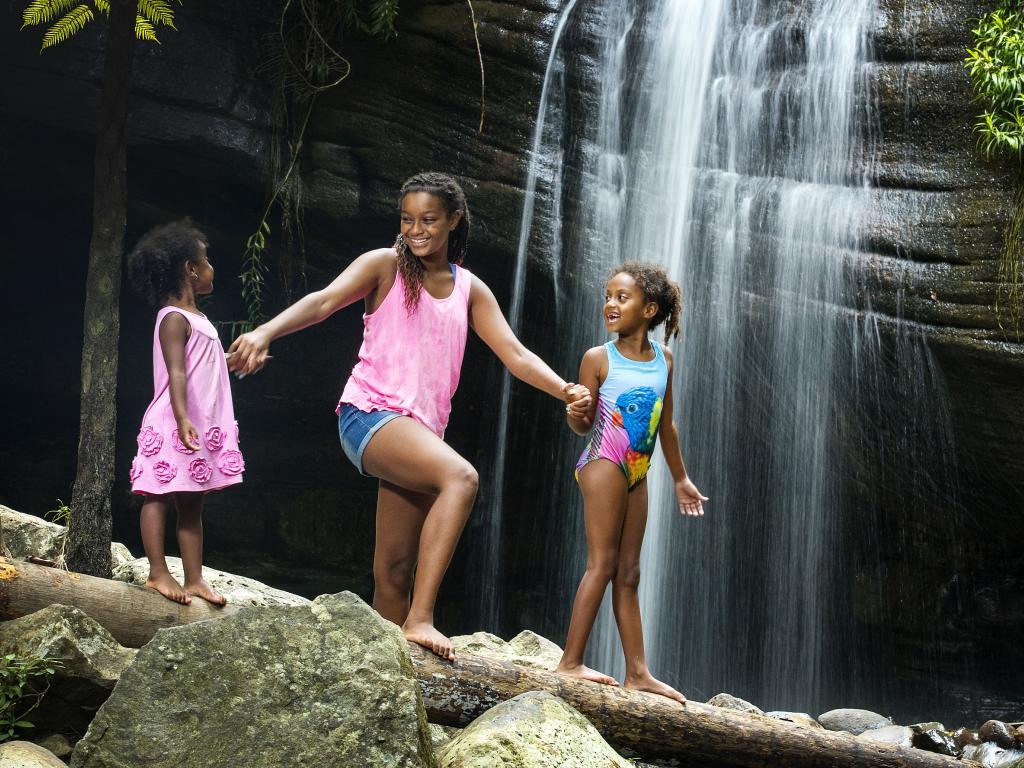 Melbourne sisters Mimi, 3, Kuleni, 12, and Tsega Venour, 6, at Buderim Falls. Picture: Lachie Millard
