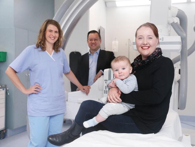Dr Kate Mahady, with RBWH director of neurology Associate Professor Andrew Wong and stroke patient Kathleen Roche, holding her son, Archie. Picture: AAP Image/Claudia Baxter