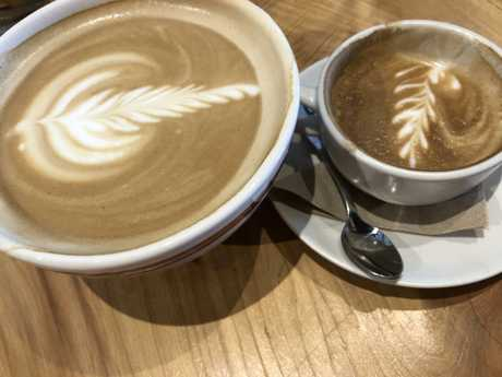To the right, a regular cappuccino. To the left, a regular latte. Huh?