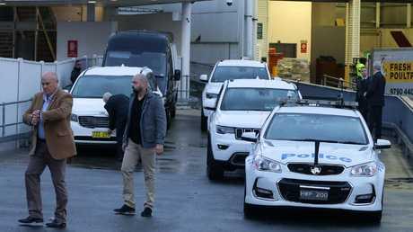 A huge police contingent waits to escorts the royals at Sydney Airport. Credit: Matrix