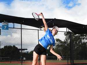 Tennis Star - Vada Thaggard serves up a ball.