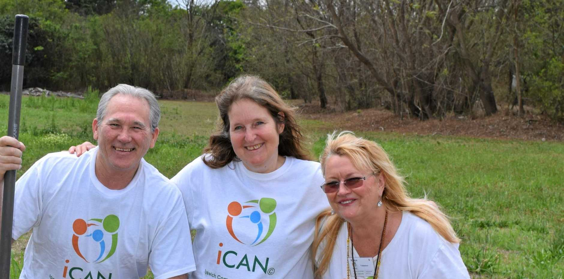 Mike Mcinnes, Conny Turni and Robyn Copper on the land which will become the new iCan community garden in West Ipswich.