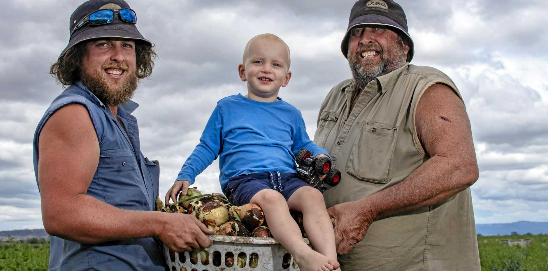 Three generations of farmers, Andrew, Cooper, 2, and Chris Mildren, Reck Farms, Lower Tent Hill.