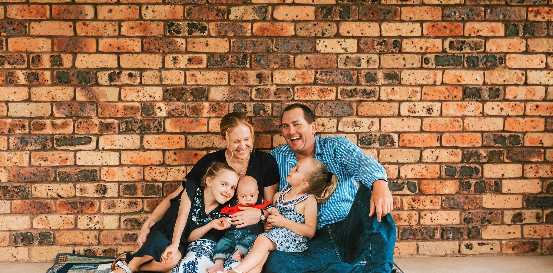 FAMILY LOVE: Ten-month-old Tommy Johnston has a terminal disease called Niemann-Pick Type C and his family wants to raise awareness. He is pictured with parents Pip and Paul Johnston and sisters Jess and Annabel in Tenterfield.