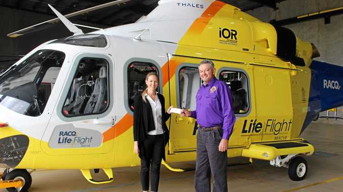 Amy Luhrs from LifeFlight accepts the cheque from Wooroolin Lions' Dave Goddard.
