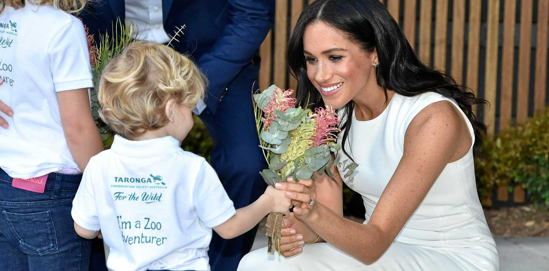 ROYAL WHITE: Meghan, the Duchess of Sussex, wears a dress designed by former Rockhampton woman Karen Gee.