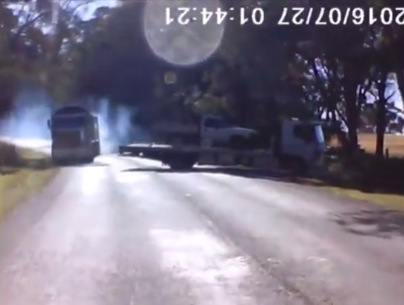 A small truck appears to do a three-point turn on a blind corner in NSW.