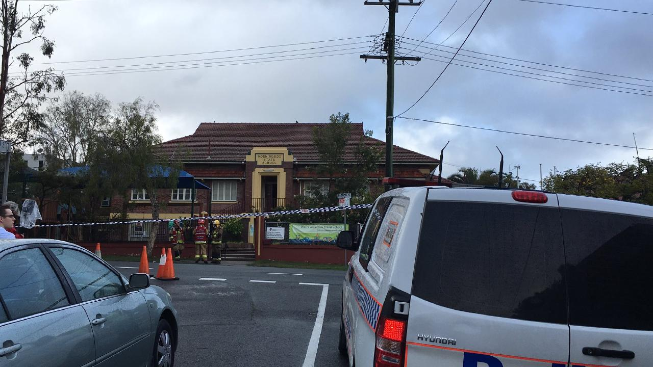 Police and emergency crews at the scene of a fire that ripped through Morningside State School in Brisbane's east. Picture: Chris Honnery
