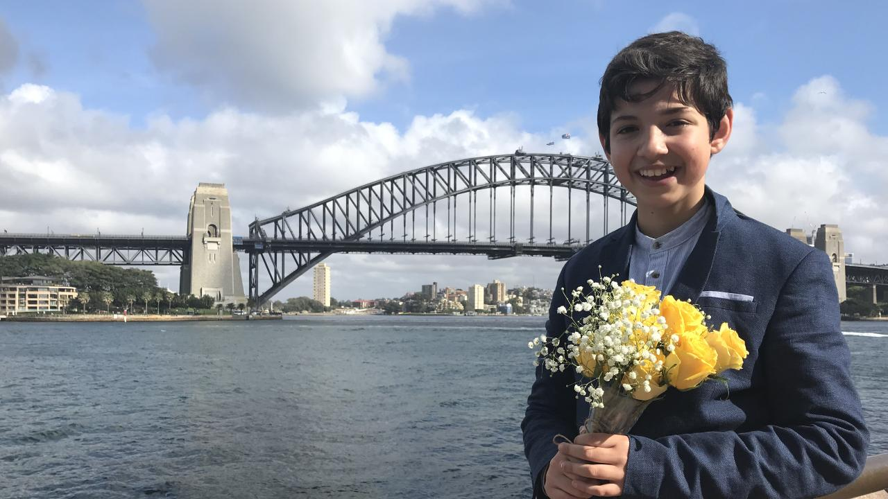 Jordan Ilencik, 14, gave school a miss today to deliver a very special message - and flowers - to Meghan. He just has to be home by 4.