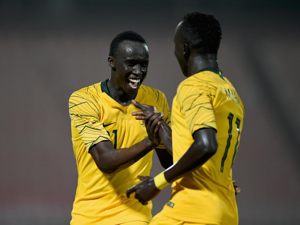 Awer Mabil (right) celebrates with Thomas Deng after scoring the fourth goal. (Photo by Tom Dulat/Getty Images)