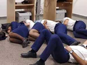 Flight crew asleep on floor photo sparks fury