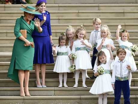 Sarah Ferguson and Princess Beatrice with the bridesmaids and page boys, including Prince George and Princess Charlotte. Picture: AP
