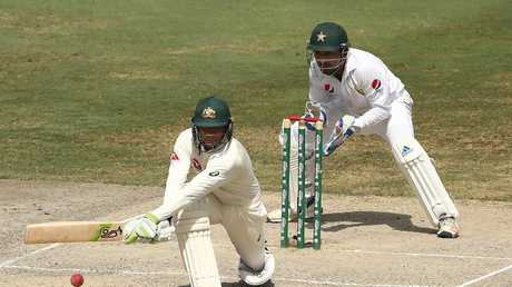 Australia snatched a morale-boosting draw on the final day of the first Test in Dubai.