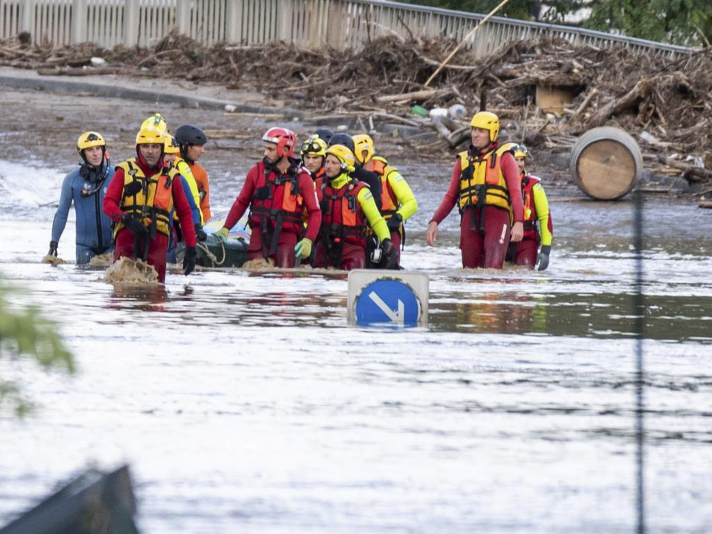 Rescue workers retrieve a body from floodwaters in the town of Trebes, southern France. Picture: AP