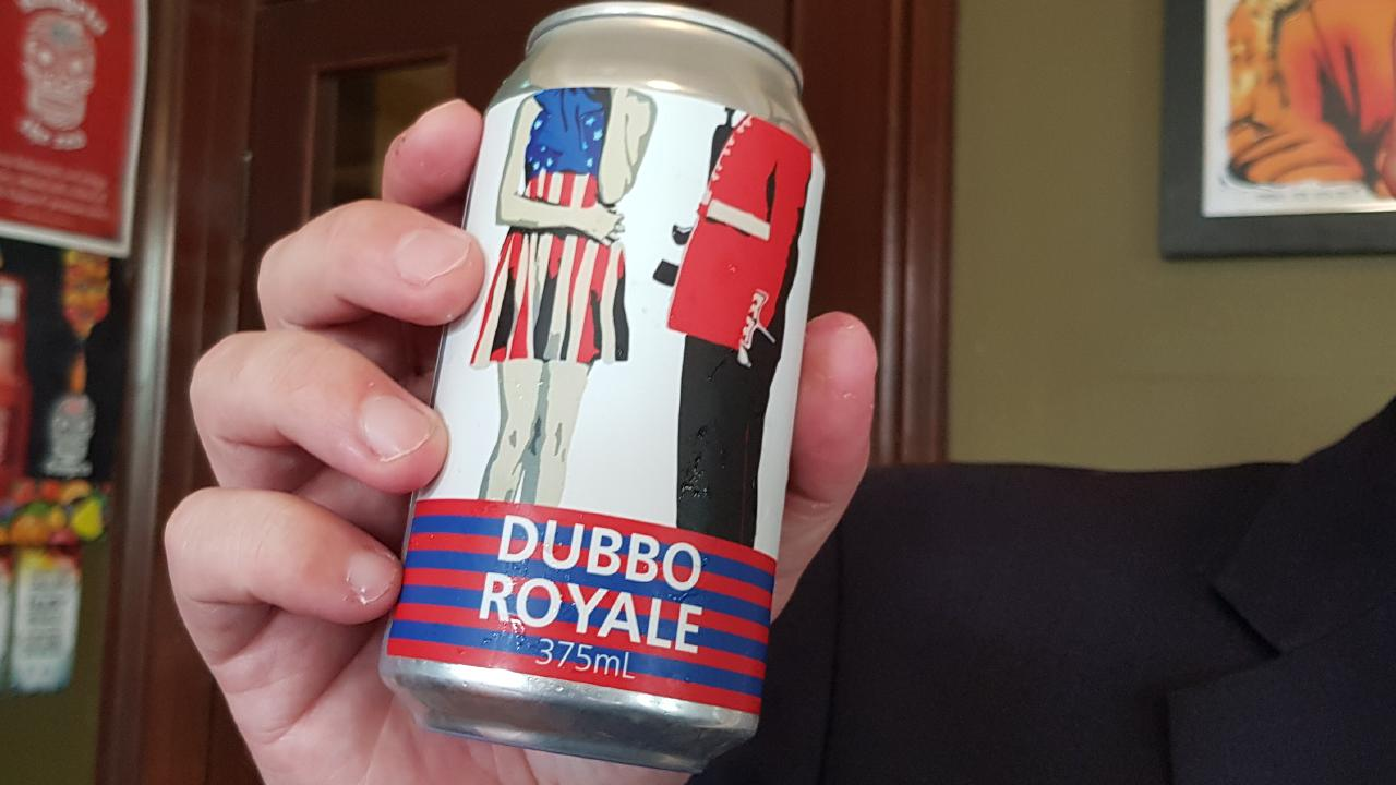 Dubbo mayor with a can of Dubbo Royale lager.