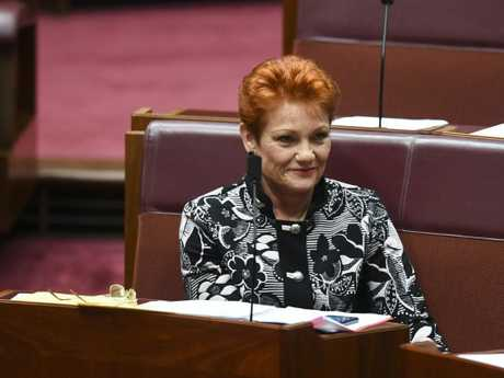 One Nation party leader Pauline Hanson reacts during debate in the Senate chamber at Parliament House. Picture: AAP
