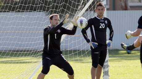 Eugene Galekovic (left) and Mark Birighitti at training.