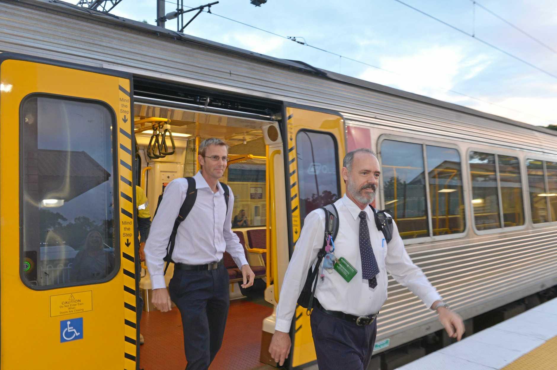 Sunshine Coast commuters Kieron Wallace and Jeff Addison want to see rail duplication.  Photo: John McCutcheon / Sunshine Coast Daily