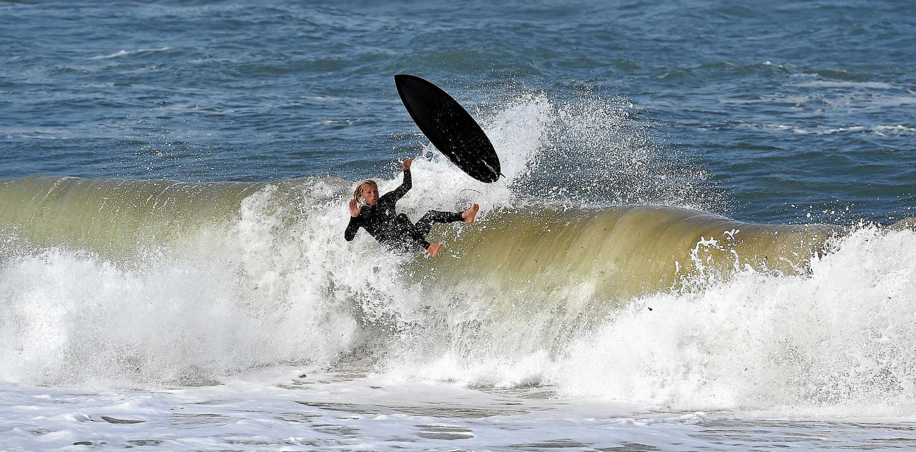 A SURFER dumped by a heavy beach break wave at Moffat Beach as rough conditions prevail across the Sunshine Coast