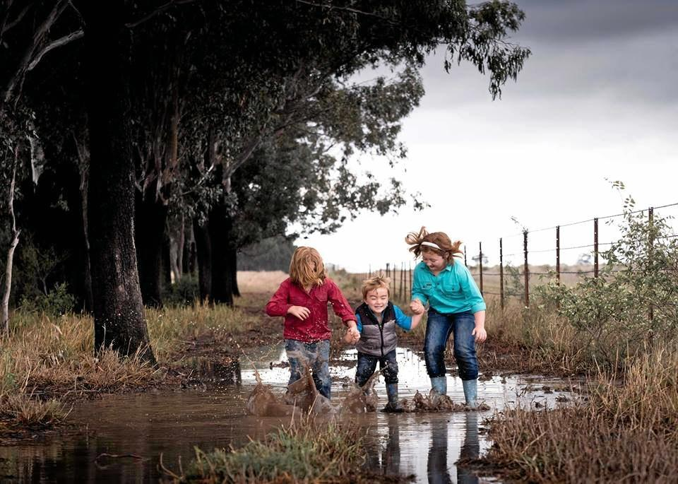 MAKING A SPLASH: Kids play in puddles north of Moura after storms bring bucket loads of rain to the Banana Shire.