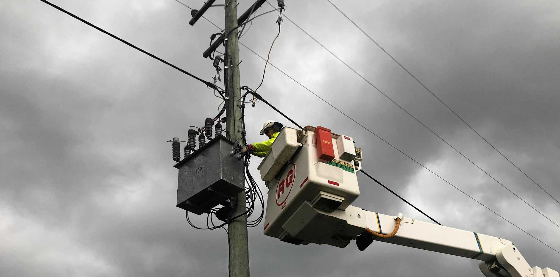 POWER OUTAGES: Bundaberg's Ergon and Energex crews were busy restoring power to more than 35,000 homes across south- east Queensland, Wide Bay Burnett, Fraser Coast and Western Downs. Allan Hall is repairing one of the lines in the Gympie region.