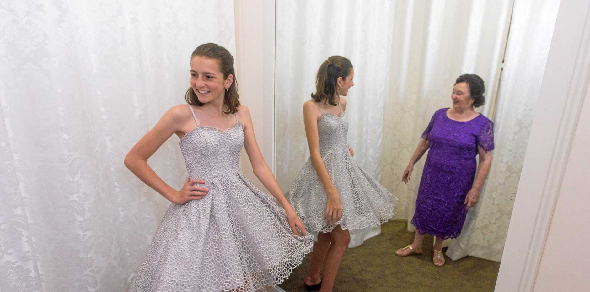 2017 Junior Jacaranda Queen Holly Blundell and 2017 Matron of Honour Patricia Hewitt try on some outfits at Lasting Impressions ahead of this week's Jacaranda Fashion Parade.