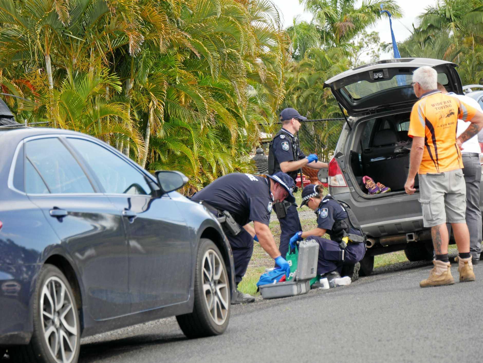 Police hunt for an offender in Takura on October 17.