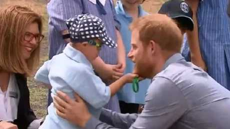 The boy reached out to give Harry a big hug and then grabbed his beard! Source: Channel 7