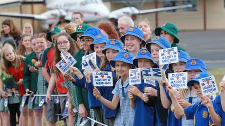 Local school kids wait to meet the royal couple. Picture: Toby Zerna