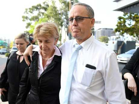 Dreamworld facilities supervisor Scott Ritchie (right) leaves the Magistrates Court at Southport on the Gold Coast on Tuesday. Picture: AAP Image/Dave Hunt