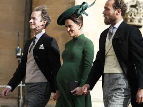Pippa Middleton arrives with her husband James Matthews, left, and her brother James Middleton for the wedding last week of Princess Eugenie and Jack Brooksbank at St George's Chapel, Windsor Castle.