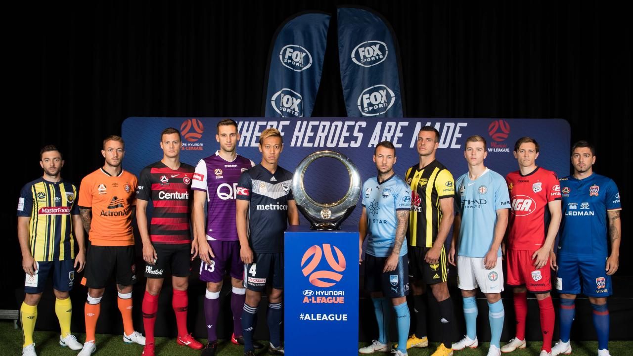 Hyundai A-League players pose with the Hyundai Trophy