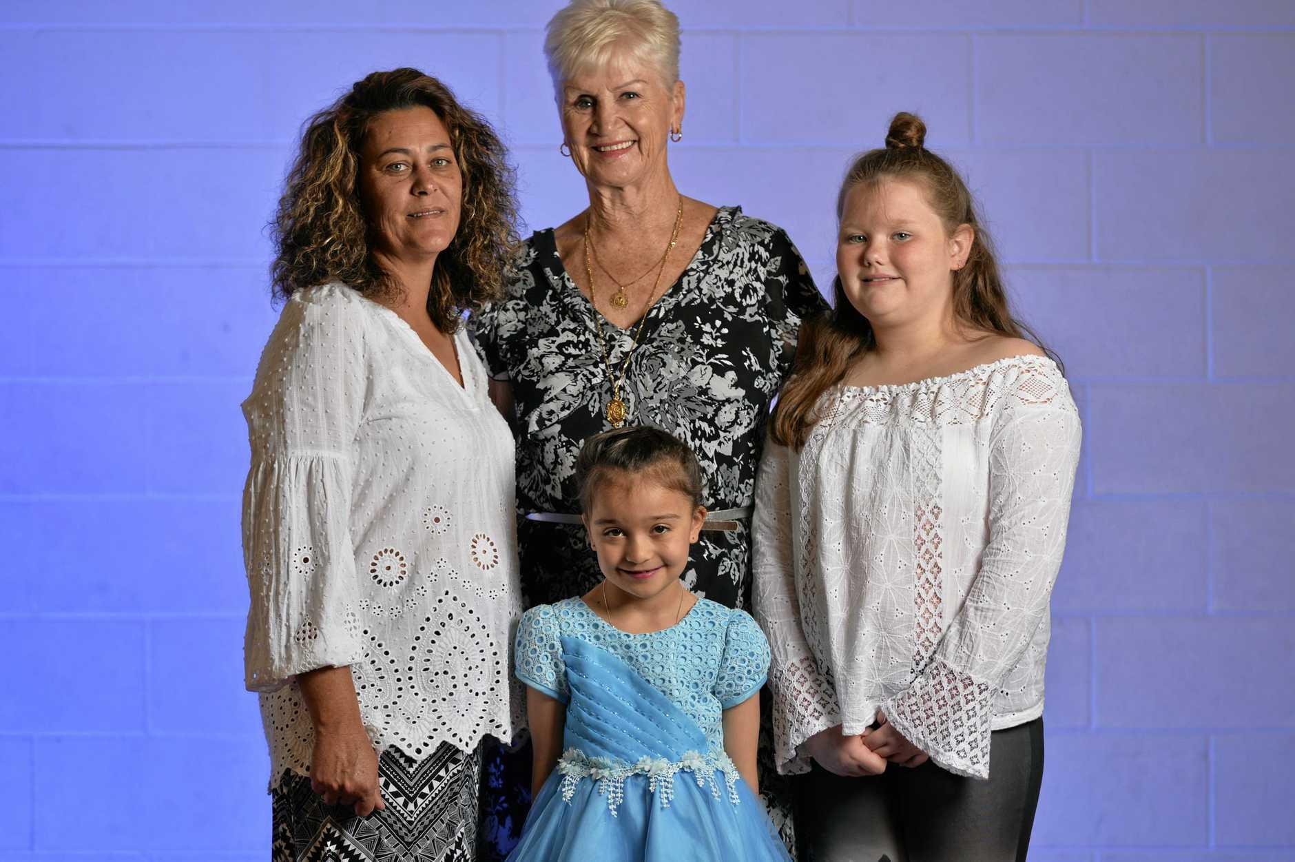 Lily Stapleton, 7, Emily Ficheroux, 11, Lee Smith (light hair) , and Jacqui stringer (dark hair) ahead of Salvos fashion show.