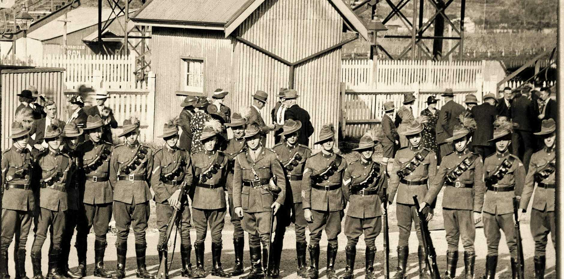 SEC221018 ali Remembrance Day Light Horse - original 100yo photo of Light Horsemen at local station PRIZED: This photograph of 16 original local Light Horse troops at Ourimbah Station has been restored after more than 100 years. Restoration: ROSIE WOOD