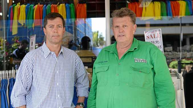 BACKING LOCALS: Menswear Direct and Shop $mart's Mark Woods (left) and Doblos Farmers Market's Dominic Doblo wish to help locals down on their luck.