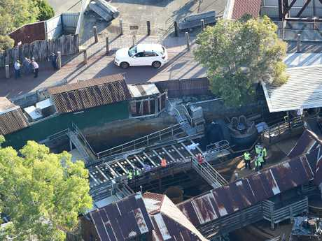 Queensland Emergency service personnel on the scene after four adults died on the Thunder River Rapids ride. Picture: AAP Image/Dan Peled