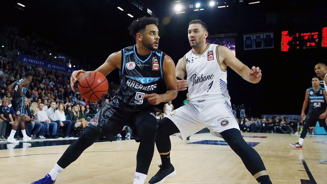 Breaker Corey Webster drives against Adam Gibson during the round one NBL clash. Picture: Getty