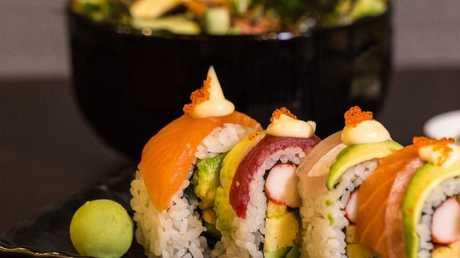 Sushi bars are a big yes at Woolies and a big no at Aldi.
