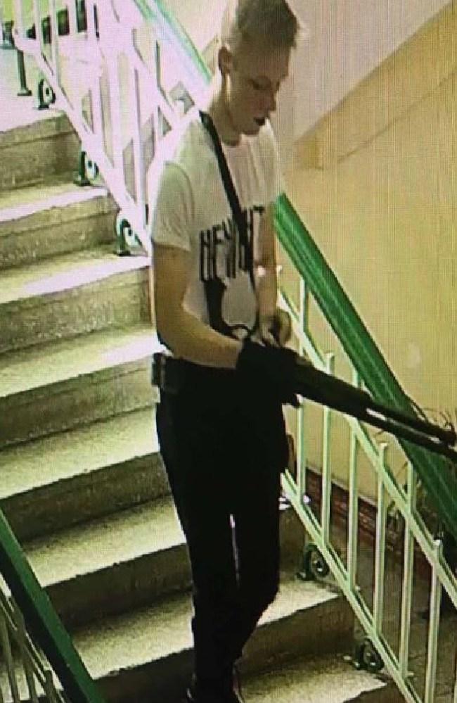 Student Vladislav Roslyakov, 18, stalking the halls of the Crimean school. Picture: CCTV