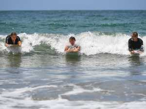 Amy White and Trent Potter share a wave with Tom
