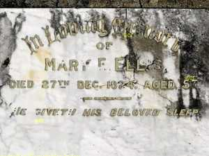 Fading headstone covers a mysterious story