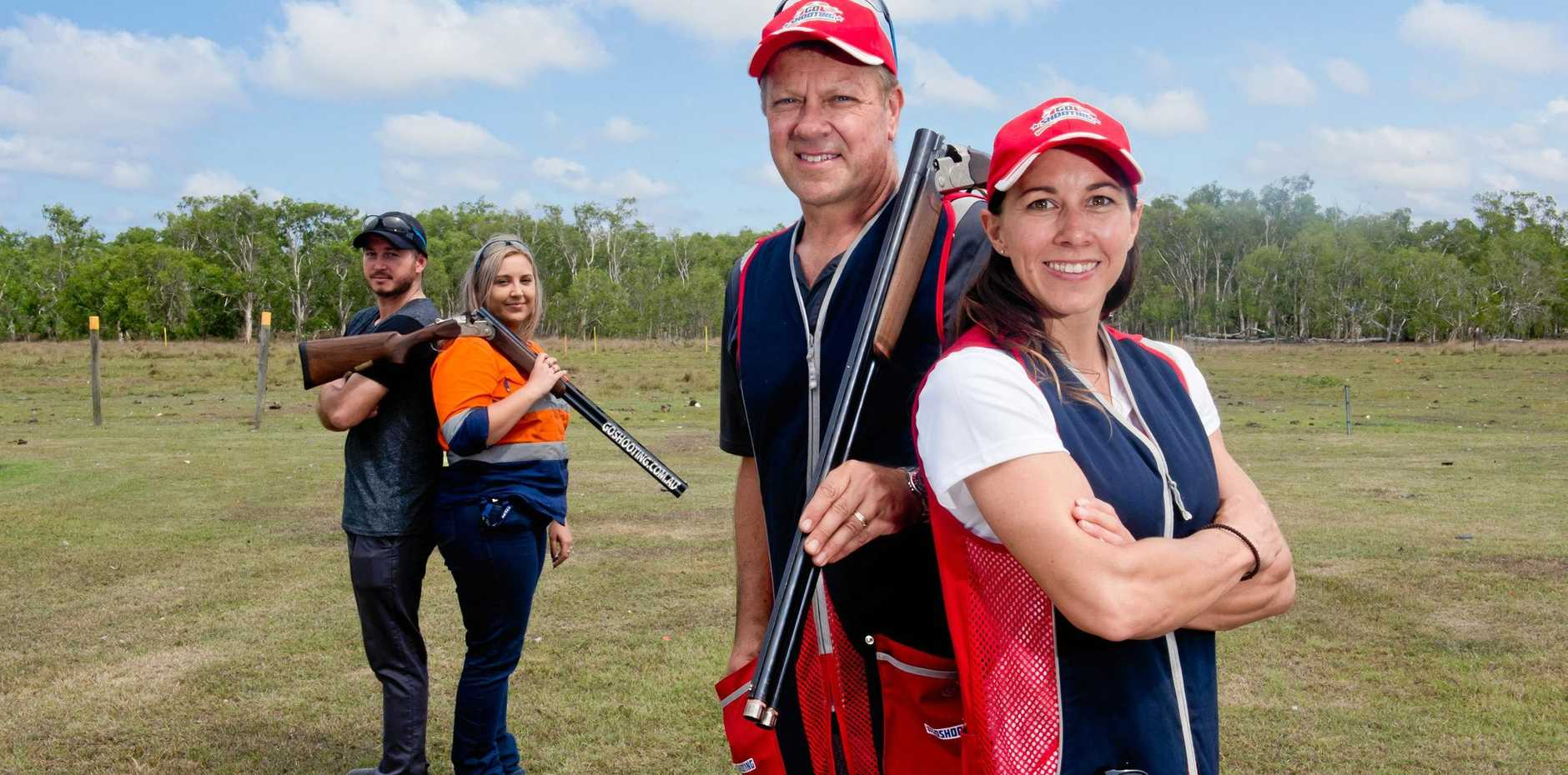 Champion shooters Russell and Lauryn Mark (right) at the Pioneer Clay Target Club teach the basics to locals Kenneth Ryan and Sarah Elvin (left).