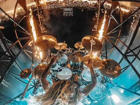 HAIR-RAISING: Parkway Drive drummer Ben Gordon spinning in the air during a performance at Aerodrome Festival.