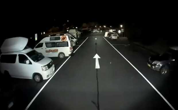 A still from Bruce Skelton's video showing a full truck parking bay - but not of trucks.