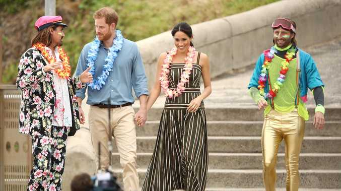 Prince Harry, Duke of Sussex and Meghan, Duchess of Sussex meet Grant Trebilco and Sam Schumacher, founder and co-founder of OneWave, a local surfing community group raising awareness for mental health and wellbeing at Bondi Beach.