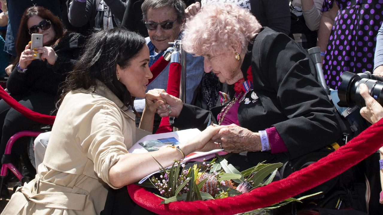 Meghan meets Daphne Dunne, saying she'd heard much about the 98-year-old. Picture: AP