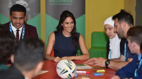 Duchess of Sussex speaks to a teacher during a visit to Macarthur Girls High School. Picture: Peter Parks